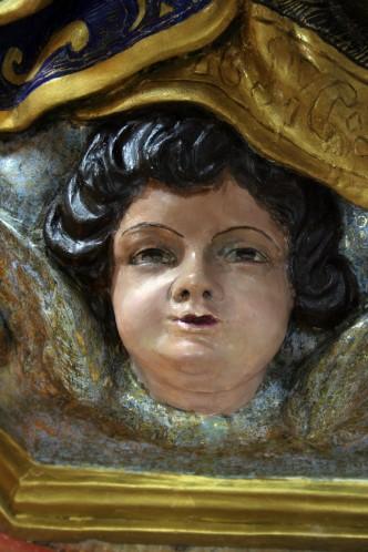 Detalle de querubín después de la restauración.